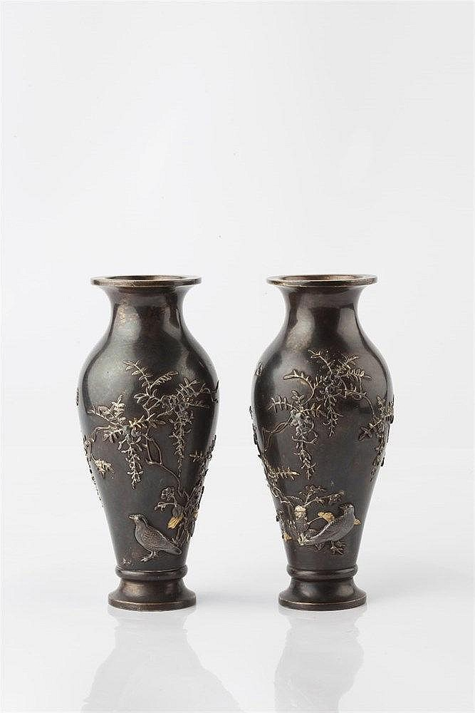A pair of Japanese bronze vases Meiji period decorated with doves