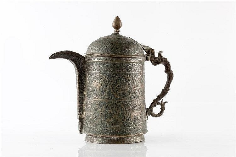 A Persian Khasmir lidded ewer embossed and engraved with animals inclu