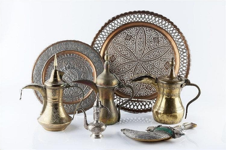 A collection of Middle Eastern metal ware including a silver metal dag