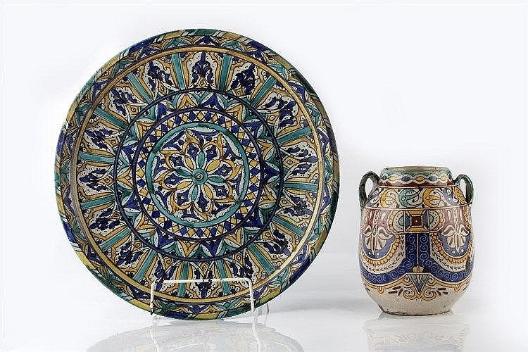 An early Moroccan stoneware dish with repeating blue and yellow patter