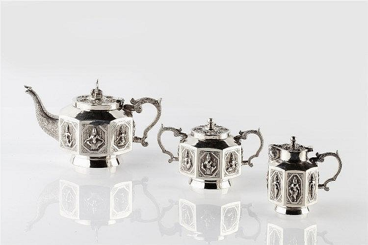 An Indian Tanjore three piece silver teaset to include a pot, jug and