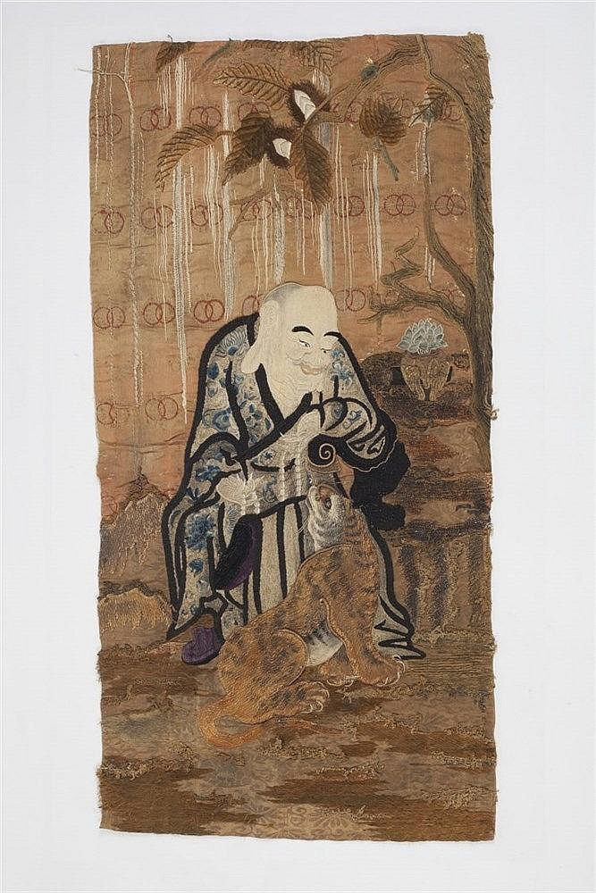 A Japanese embroidered panel of gold embroidery depicting a wise man w
