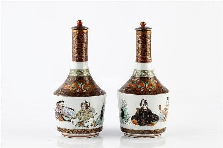 A pair of Japanese Kutani sake bottles and stoppers late Meiji period