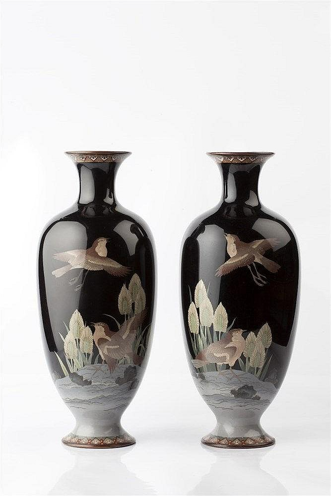 A pair of Japanese cloisonne vases Meiji period decorated with fl