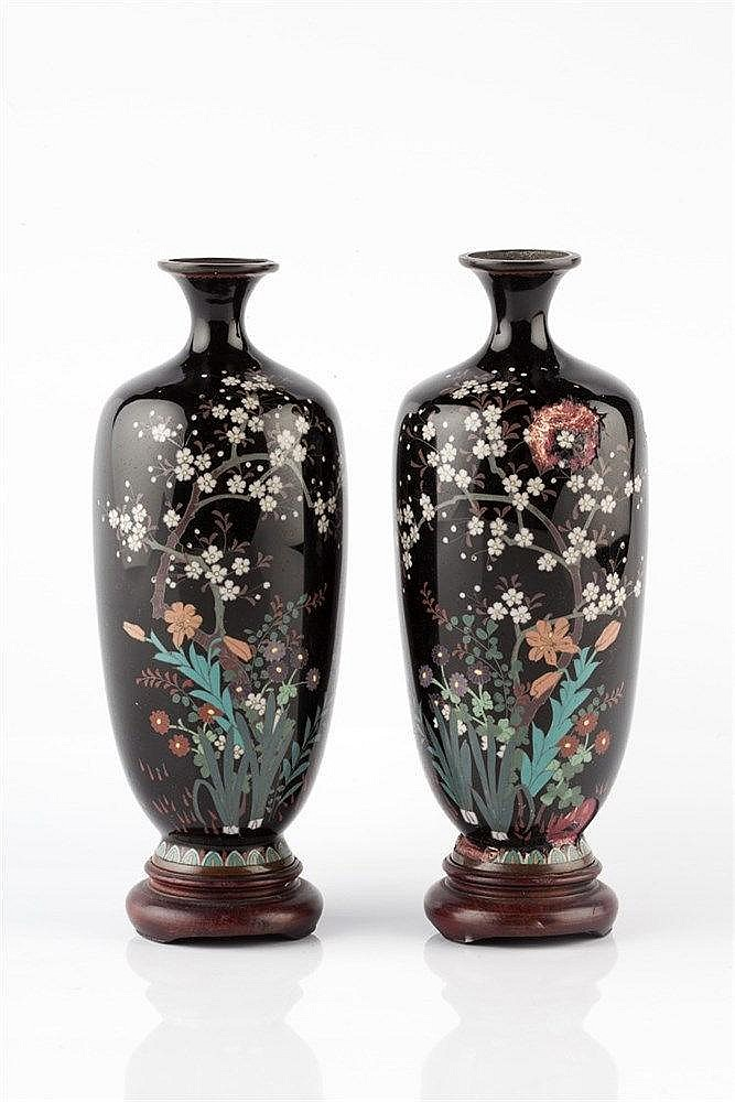 A pair of Japanese black ground cloisonne vases Meiji each decora