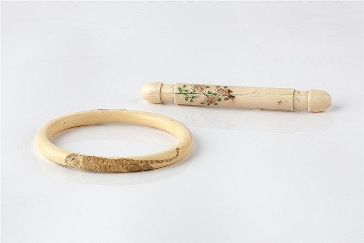 A Japanese ivory bangle Meiji period carved with two tigers, a ne
