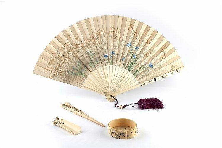 A Japanese folding paper fan late Meiji painted with figures trav