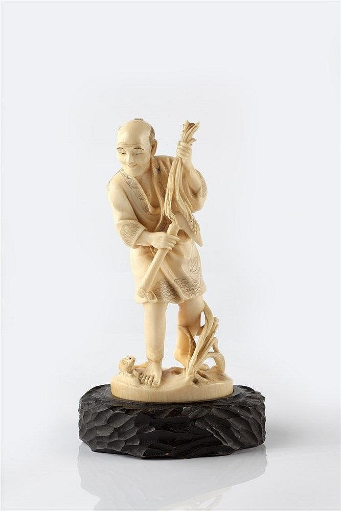 A Japanese ivory okimono late Meiji period signed on inset red ta
