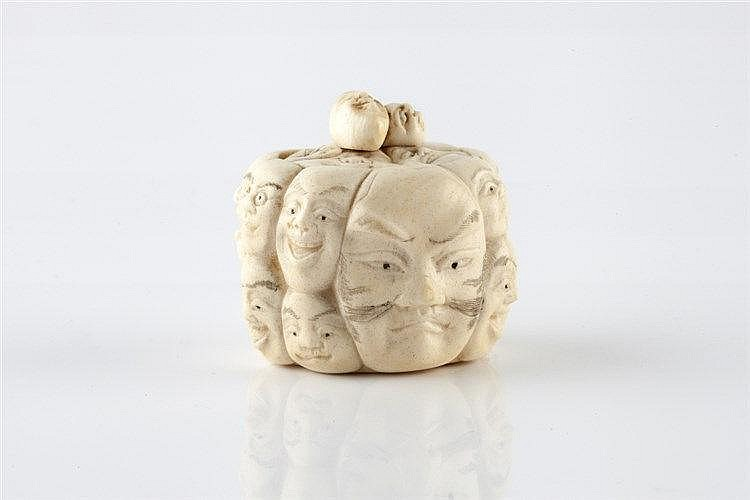 A Japanese ivory miniature box and cover Meiji period carved in t