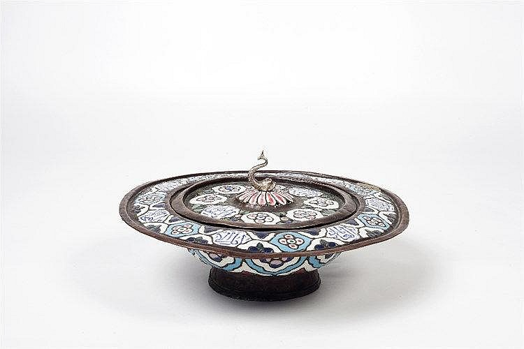 A Syrian brass lidded basin with blue, red and white enamel within an