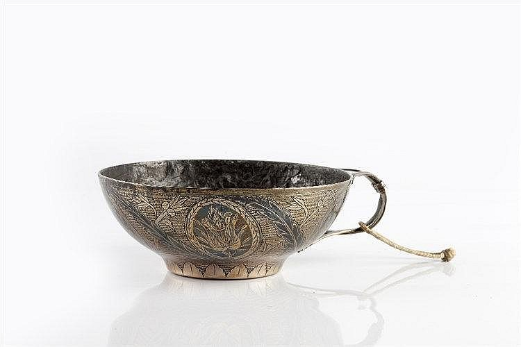 A Persian silver metal plated cup 19th century with leaf shaped handle