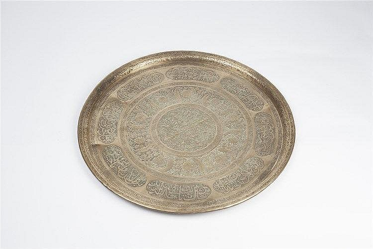 A Middle Eastern brass tray  19th Century engraved with boarders of Is