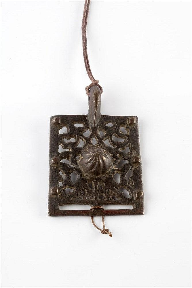 A Persian belt buckle of square form with fret work pattern, 8cm x 7cm