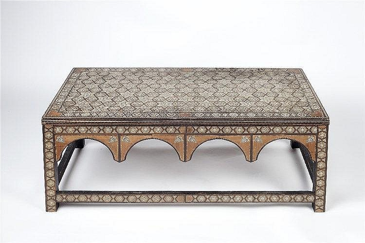 An Ottoman low table with geometric inlaid top, 100cm x 50cm