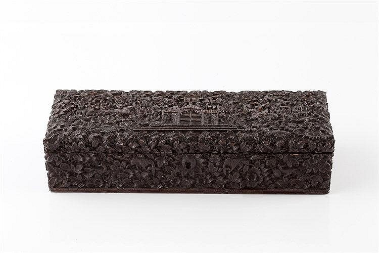 An Indian carved hardwood rectangular box 19th Century with central sm