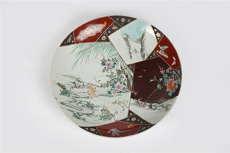 A large Japanese Imari charger late 19th Century with central vas