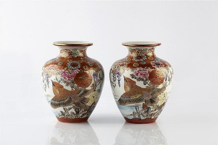 A pair of Japanese Kutani vases Meiji painted with blossom and bi