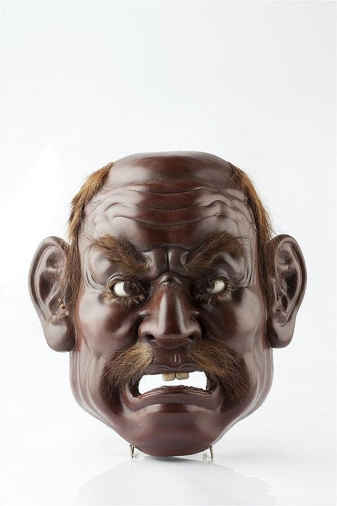 A Japanese Gigaku mask Meiji period of lacquered wood in the earl