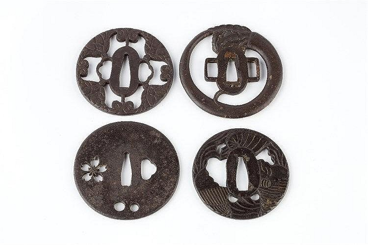 Four Japanese Tsubas  the first tsuba decorated with geometric shapes,