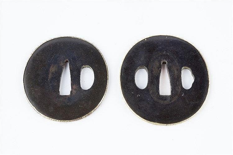 Two Japanese Tsubas circa 1700 a matched Daisho, of polished shak