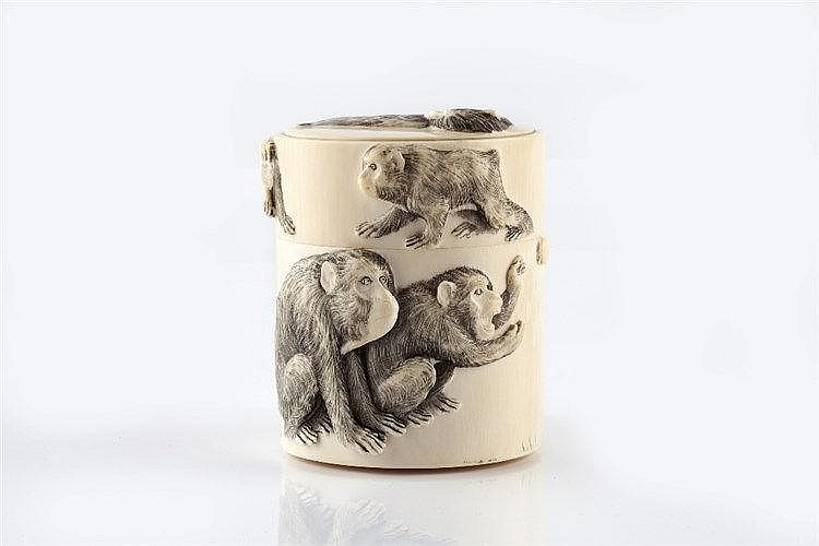 A Japanese ivory cylindrical canister and cover late Meiji carved