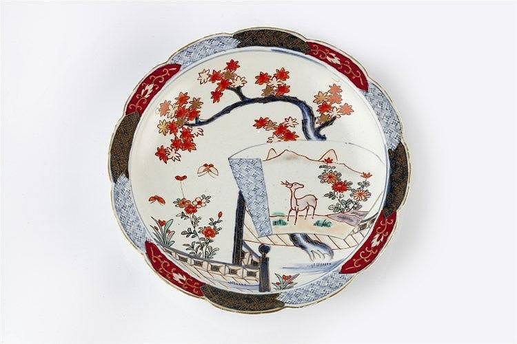 A Japanese Arita dish 18th Century with scalloped edge decorated with