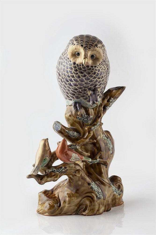 A Japanese Kutani porcelain sculpture of an owl and two song birds Mei