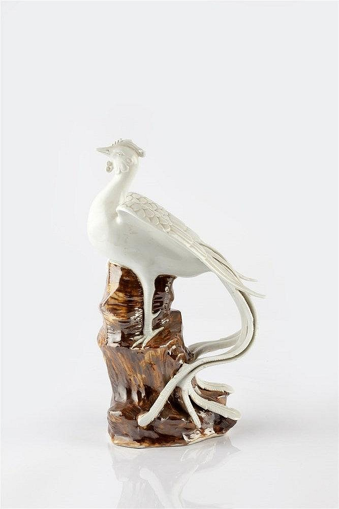 A Japanese Hirado model of a ho ho bird 19th Century seated upon a roc