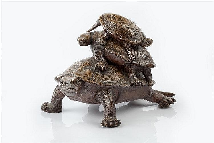 A Japanese bizen ware model of three turtles Meiji period signed