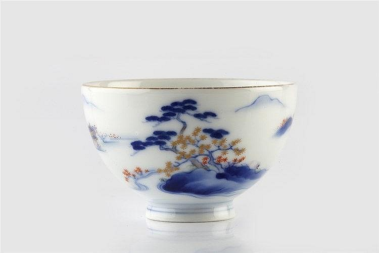 A Japanese Fukagawa tea bowl circa 1900 with pagoda and landscape