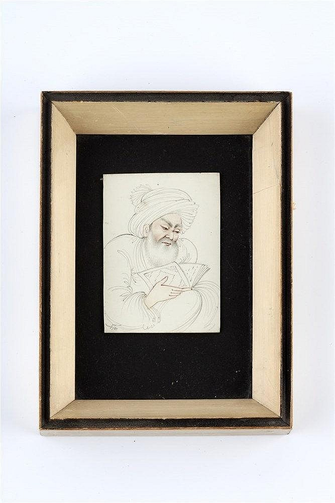 Persian School A study of a scholar's head holding a Quran, on ivory,