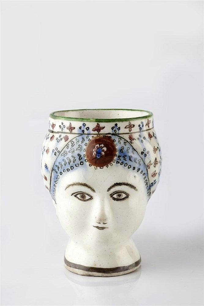 A Persian fritware mug Qajar dynasty, 19th Century in the form of