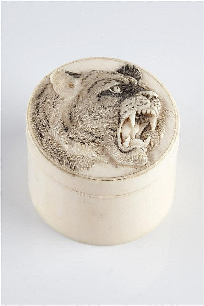 A Japanese ivory cylindrical box and cover late Meiji period (1868-191