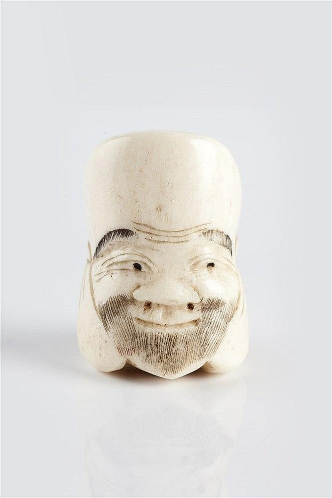 A Japanese Ivory netsuke Meiji Period (1868-1912) carved as a Noh