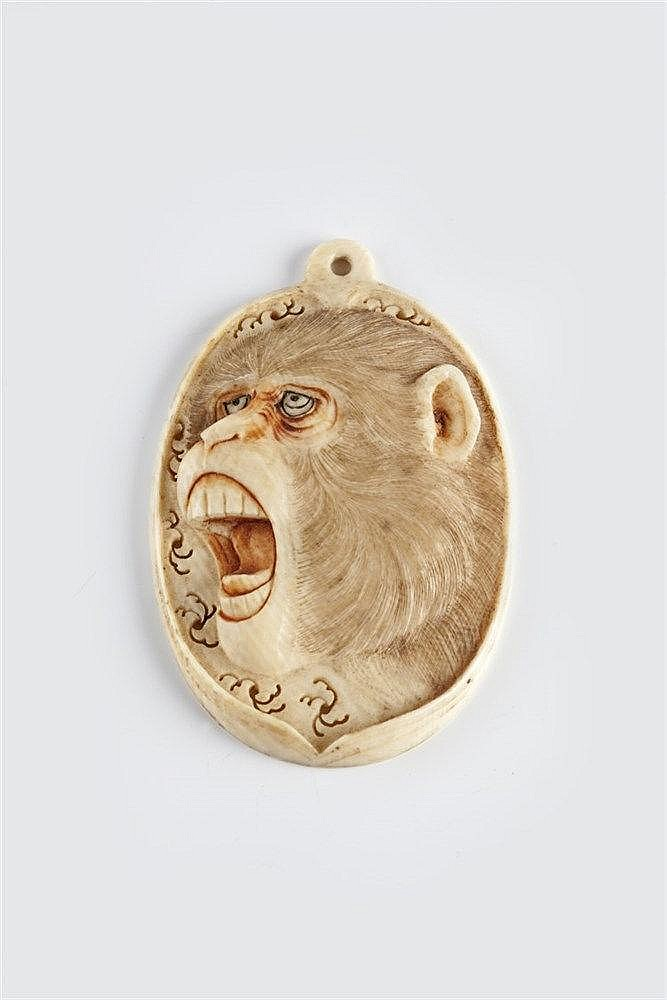 A Japanese ivory pendant Meiji Period (1868-1912) carved with the