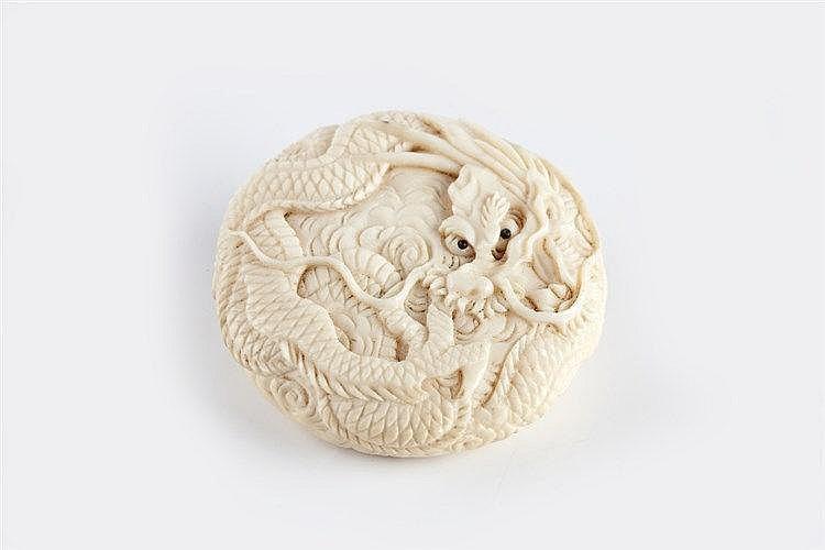 A Japanese ivory Manju netsuke Meiji period (1868-1912) carved de