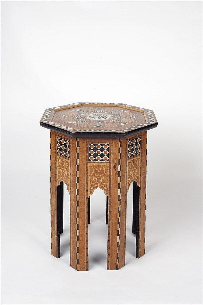 A octagonal Ottoman table with geometric wood and mother of pearl inla