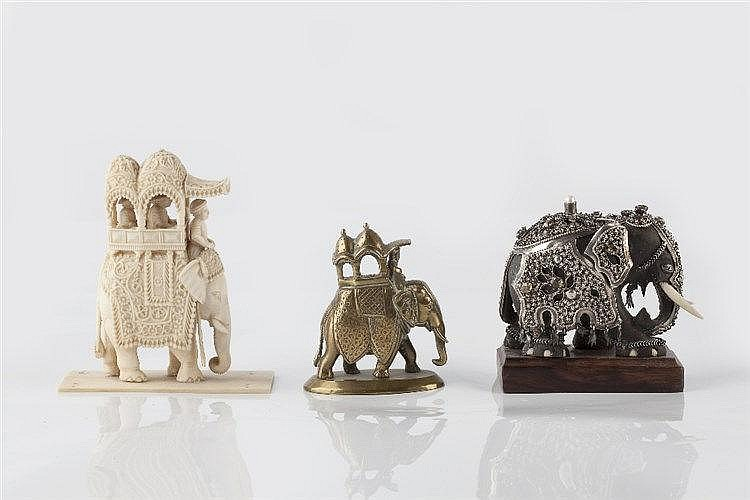 An Indian caved wooden and ivory elephant decorated with metal armour