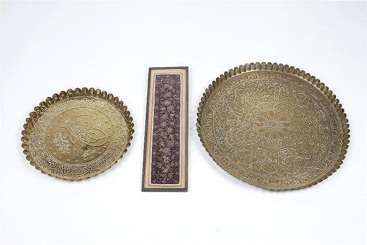 Two brass Ottoman petal-edged trays each embossed with scripture and f