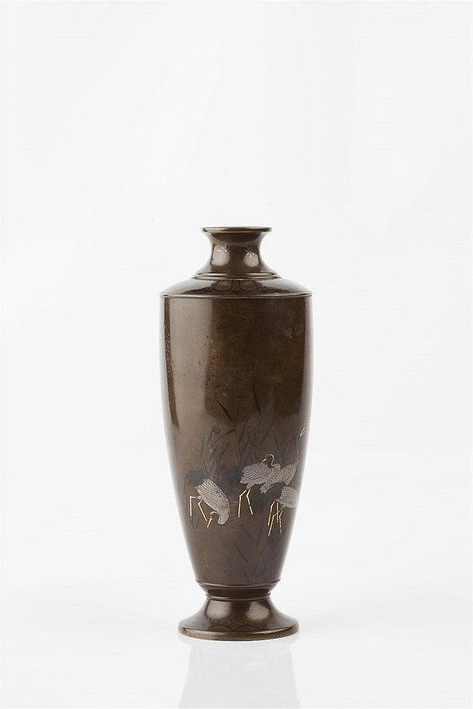 A Japanese bronze vase Meiji period Hattori workshop, decorated i
