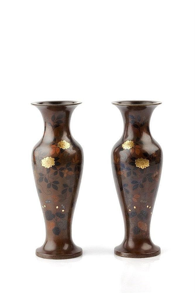 A pair of Japanese slender bronze vases Meiji period Hattori work