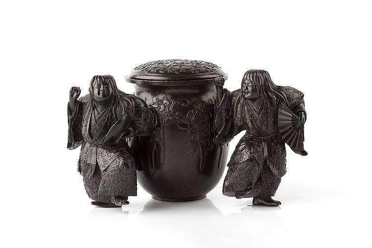 A Japanese bronze okimono Meiji period modelled as two standing s