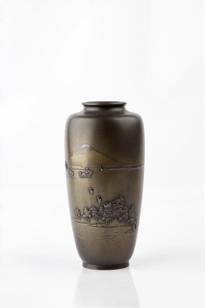 A Japanese bronze vase Meiji period signed, inlaid in silver show