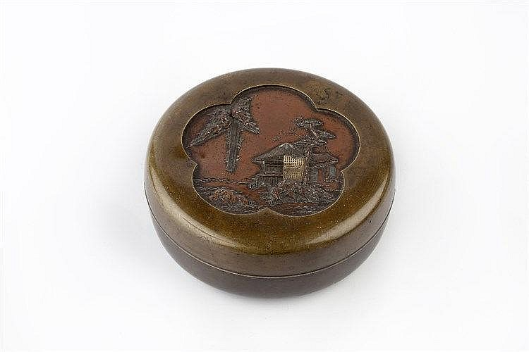 A Japanese bronze kogo Meiji period carved in high and low relief