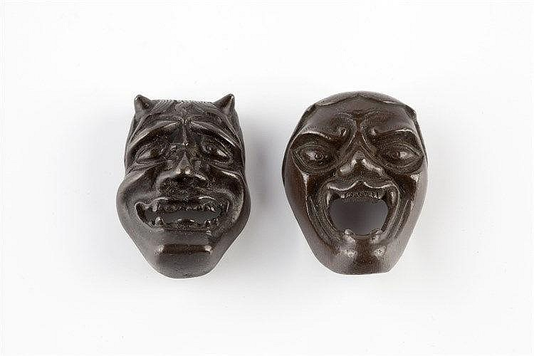 A bronze netsuke mask of Hannya Edo period and another of Shishig