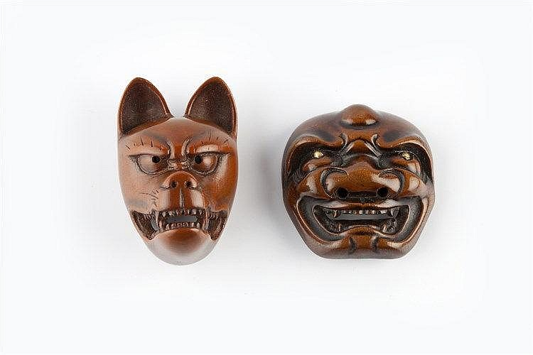 A wood netsuke mask of a fox (Kitsune) Edo period the facial expression s