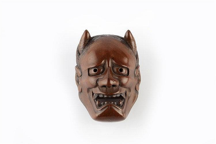 A wood Noh type netsuke mask representing Hannya early Meiji signed and w