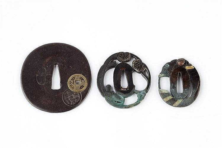 Three Japanese Tsubas  the first a sentoku tsuba, depicting Jitoku wit