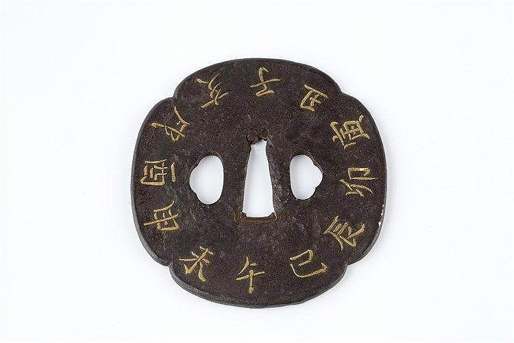 A Japanese Tsuba  18th Century in the morra form, decorated with twelv