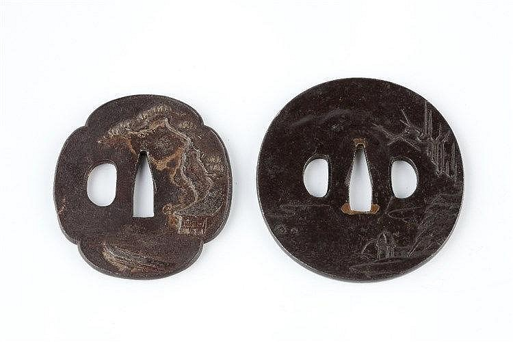 Two Japanese Tsubas the first tsuba, Choshu school, decorated showing
